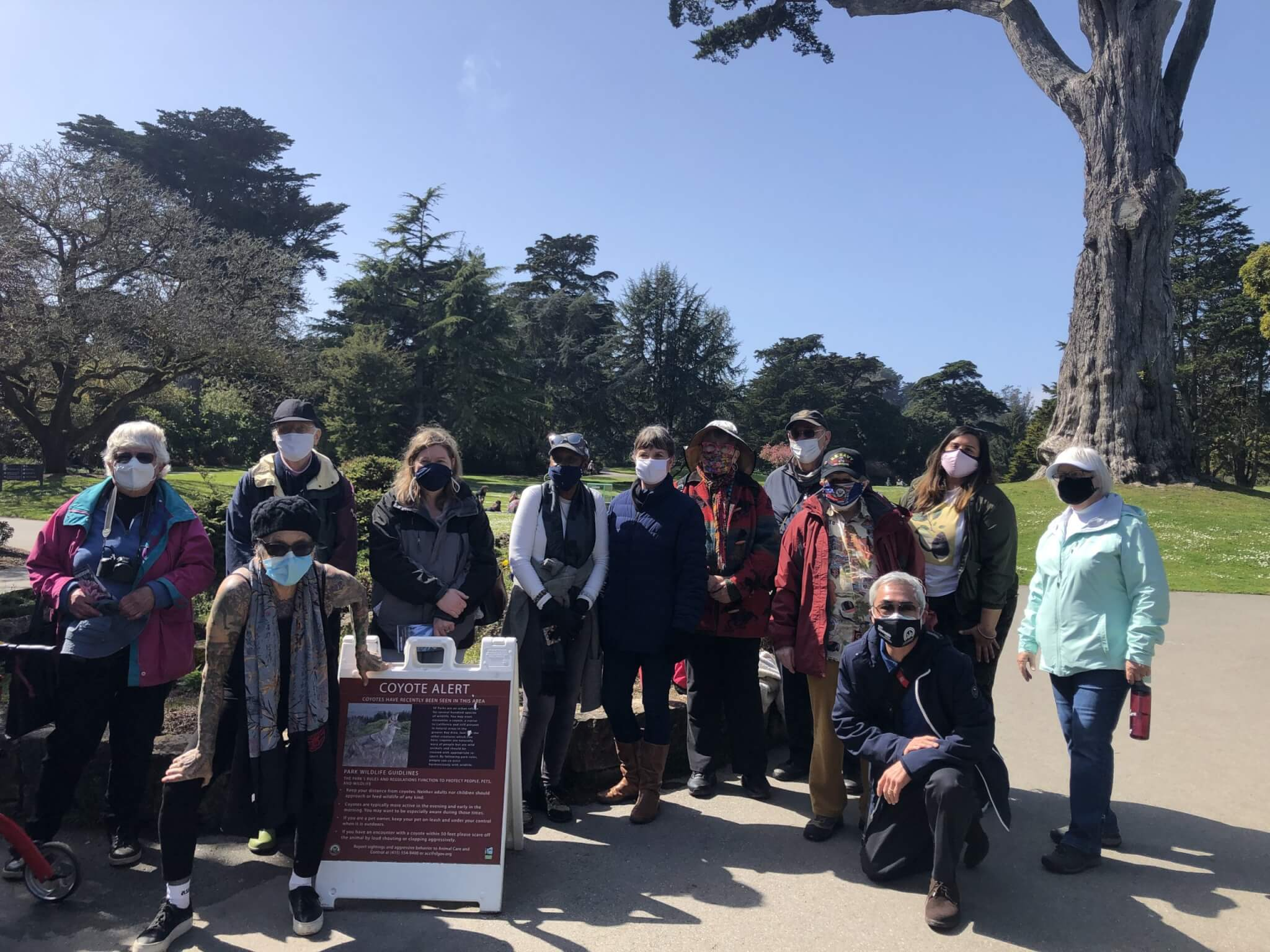 Members of San Francisco Senior Center's Plant Chat group standing together outside