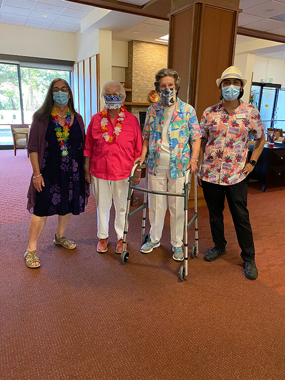 A group of residents and staff at The Tamalpais wearing Hawaiian attire